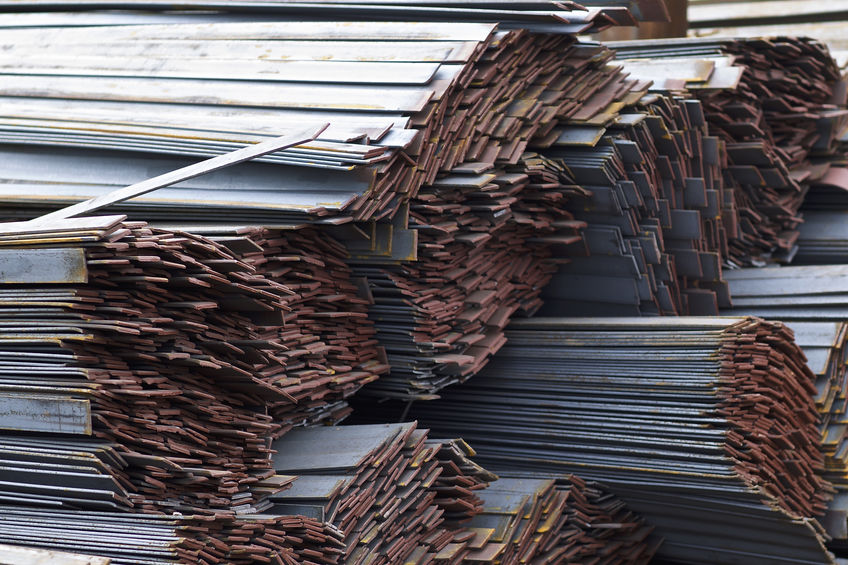 Metal profile strip in packs at the warehouse of metal products
